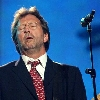 "Eric Clapton performs ""Stormy Monday"" during the Pavarotti & Friends charity concert for Iraqi children at the Novi Sad Park in Modena, Italy, Tuesday, May 27, 2003. (AP Photo/Alberto Pellaschiar)"