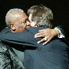 "Music legends B.B. King (L) and Eric Clapton hug on stage after their performance during the ""Blowin' the Blues Away"" concert at the Apollo Theatre in New York City, June 2, 2003. The concert was part of a series of events marking 2003 as the ""Year of the Blues."" REUTERS/Jeff Christensen"